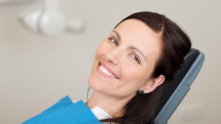 woman at dentist | dentist aloha oregon